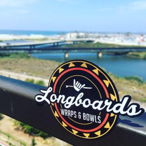 Raise your Monday Morning Coffee in Aloha to Northwest Missouri's favorite wrap restaurant — Longboards Wraps and Bowls.