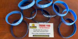 """Stop by the office of Don Tolly to receive a """"Pay it Forward"""" card and bracelet."""